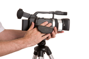 hands of man with camera isolated on white background
